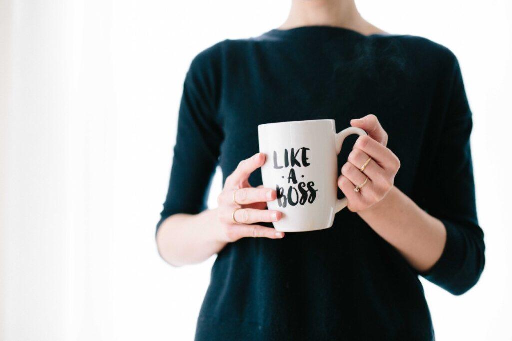 woman holding a like a boss mug