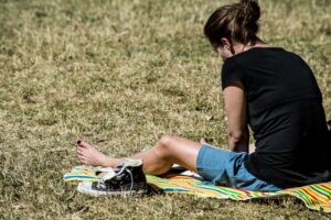 girl sitting on grass studying